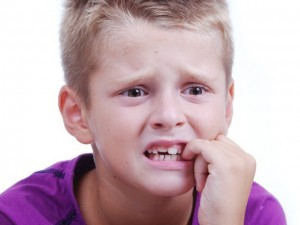 Stress expression on little blond kids face